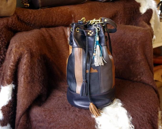 sac  bourse patchwork en cuir  noir et marron