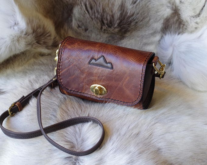 Small distressed brown leather shoulder bag