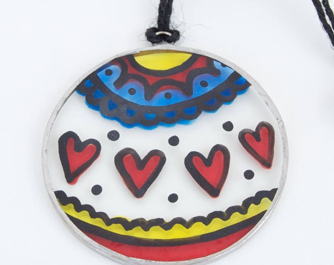 Ball with hearts. Christmas glass ornament to hang on the Christmas tree, in the window, wall. Stained glass Tiffany. Ready to ship