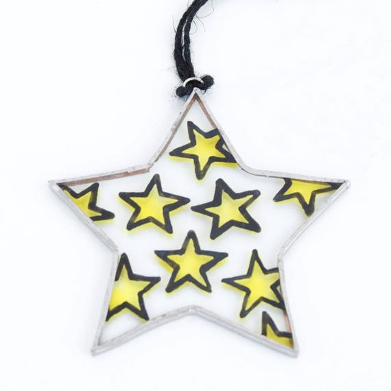 Star. Christmas glass ornament to hang on the Christmas tree, in the window, wall or ceiling. Stained glass Tiffany. Ready to ship