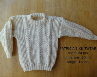 Childs Sweater Approx 2 years in Cream Aran, 24ins chest, hand knitted with crew neck.