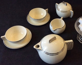 Art Deco china tea set . Badonviller french ceramic . Coffee pot . Teapot .  Cream pot . Sugar bowl . cup.