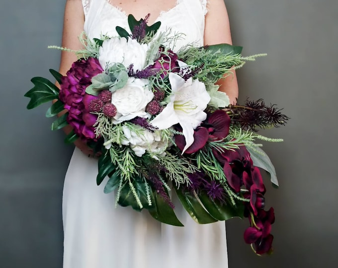 Plum purple white tropical flowers wedding bridal bouquet, cascading greenery orchid lily rose monstera banana leaf grasses, big original