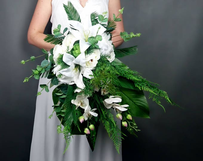 White wedding bouquet, tropical greenery leaves orchid lily flowers bridal bouquet cascade ferns eucalyptus monstera banana leaf