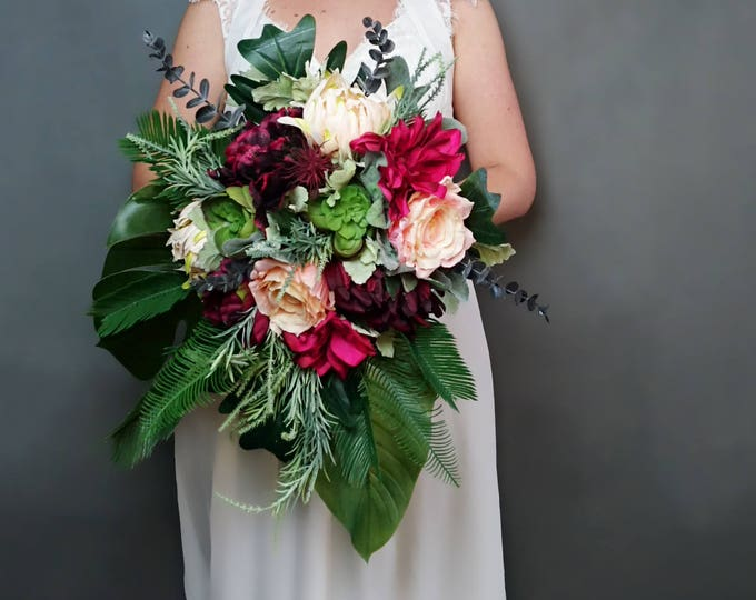 Burgundy fuchsia peach cream tropical flowers wedding bridal bouquet cascade greenery dahlia rose ferns eucalyptus monstera banana leaf big