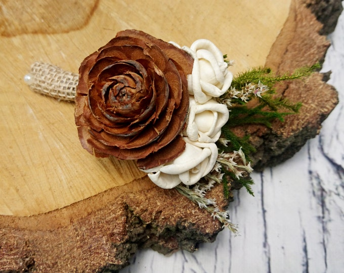 Woodland wedding cedar rose boutonniere