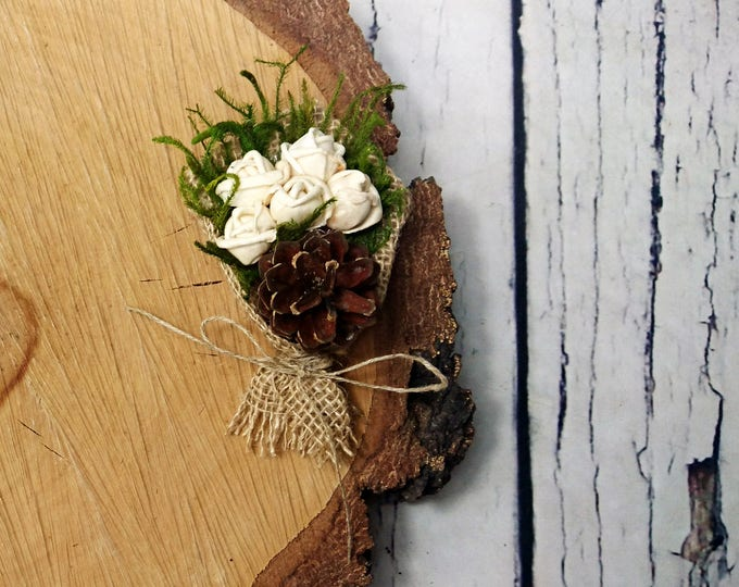 Winter wedding pine cone boutonniere with greenery and sola flowers