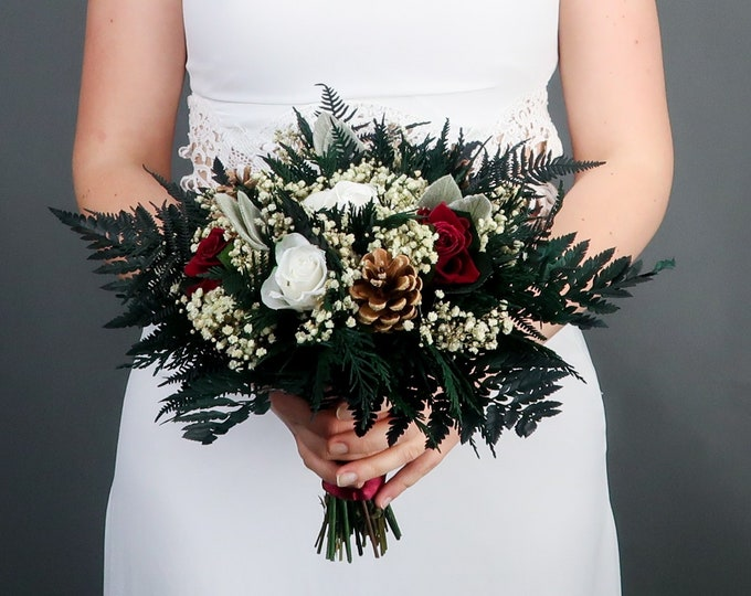 Burgundy and white winter wedding bridal bouquet pine cones real preserved roses and greenery real flowers woodland wedding