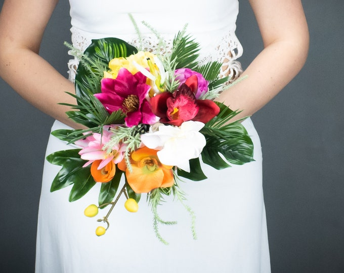 Colorful tropical wedding realistic artificial bouquet, monstera leaves orange fuchsia orchids, yellow calla lily, cascading bridal bouquet