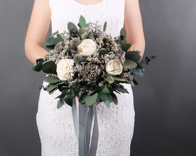 Ivory and gray sola flowers bridal bouquet with echinopses and preserved eucalyptus