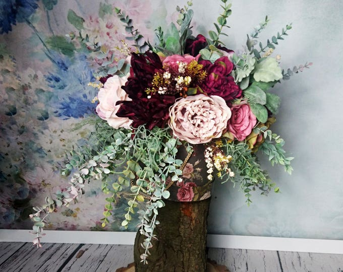 Vintage style floral arrangement boho wedding burgundy blush pink roses eucalyptus wild flowing asymmetrical for pedestal aisle decor fall