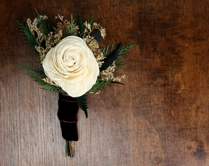 Winter wedding woodland boutonniere with ivory sola rose, pine cones, gold dried flowers and preserved woodland greenery