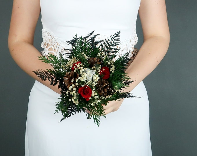 Tiny winter wedding bouquet with pine cones and real preserved roses