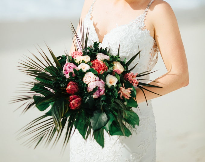 Real preserved flowers tropical cascading bouquet with pineapples proteas palms and monstera leaves, beach wedding, pink peach green bouquet