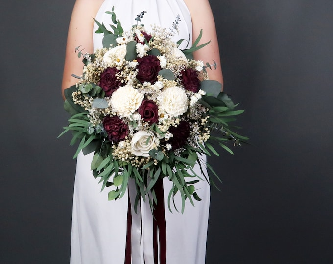 Cascading boho wedding bouquet in burgundy and ivory