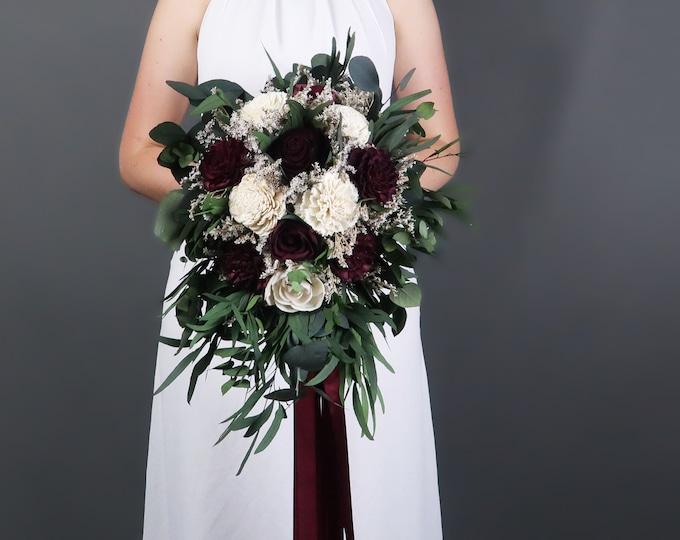Southwestern boho wedding bouquet preserved eucalyptus Burgundy wine ivory sola flowers vintage style long ribbon bridal cascading greenery