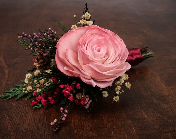 Woodland Groom's boutonniere with pink sola rose