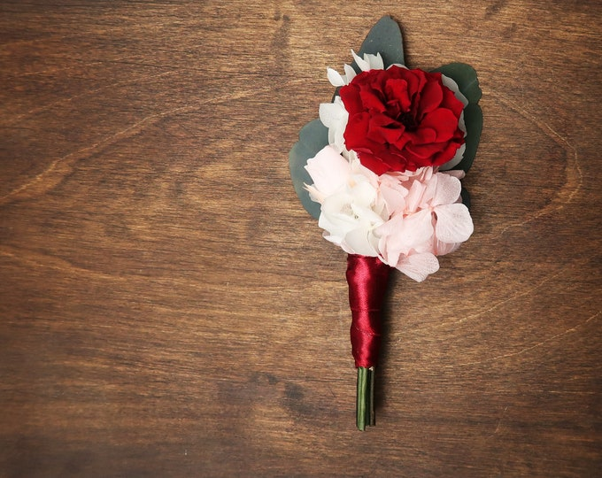Deep red, white and blush pink wedding boutonniere
