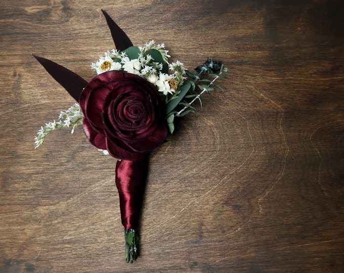 Natural wedding groom's boutonniere preserved eucalyptus burgundy sola rose flower greenery fall winter vintage elegant
