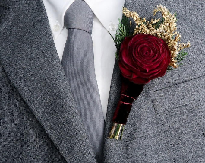 Burgundy rose winter wedding woodland boutonniere with sola flower, gold dried flowers and preserved woodland greenery
