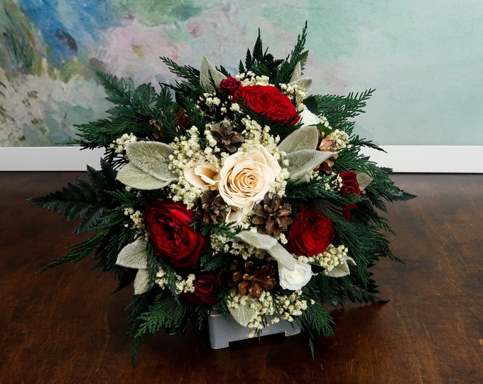 Medium winter wedding bridal bouquet with pine cones, berries and real roses in burgundy, white and champagne, natural realistic flowers