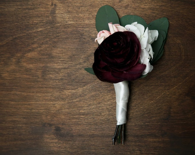 Natural groom boho wedding boutonniere dark wine burgundy sola rose blush buds white hydrangea preserved eucalyptus