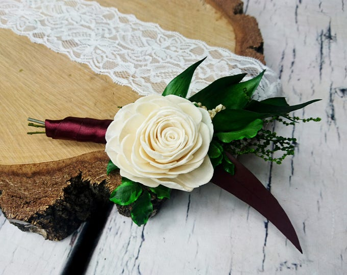 Boho wedding boutonniere in shades of ivory, wine and green