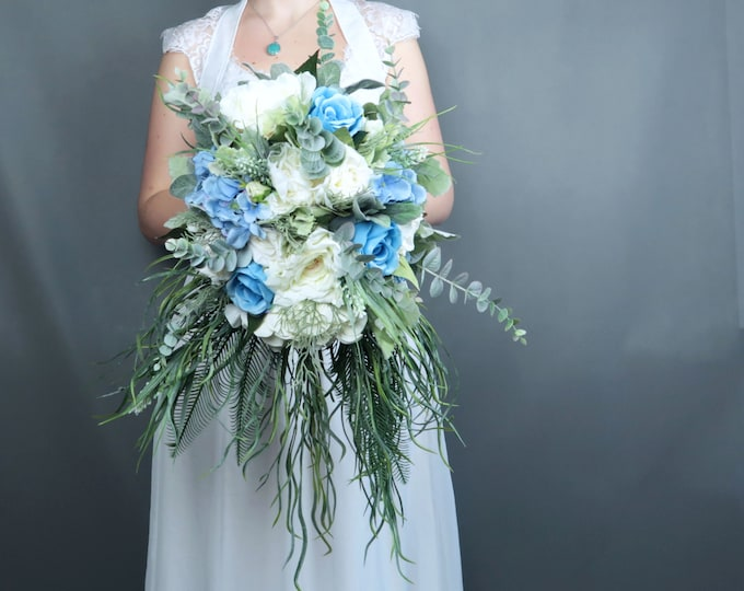 Cascading greenery pastel blue white ivory flowers bridal bouquet Best quality dusty miller roses hydrangea eucalyptus southwestern wedding