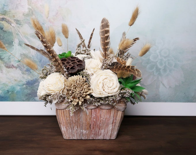 Southwestern rustic boho wedding table centerpiece sola flowers feathers succulents grasses earthy colors brown ivory green desert wedding