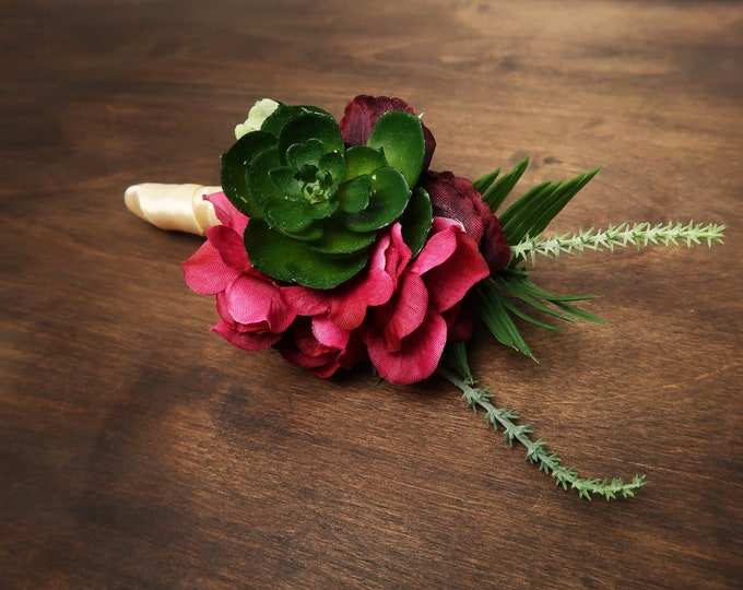 Tropical wedding succulent boutonniere in fuchsia, peach and burgundy