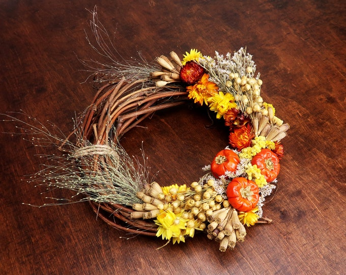 Rustic dried flowers fall wreath with pumpkins