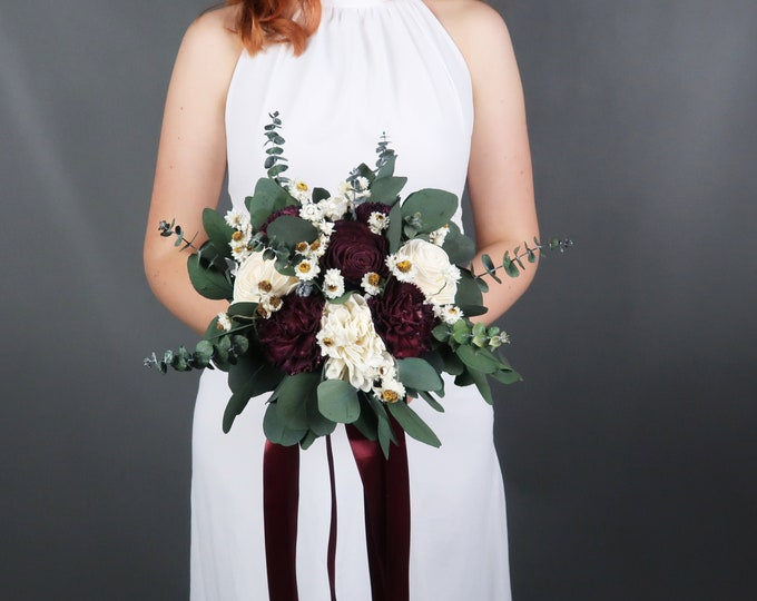 Burgundy wedding wooden flowers bouquet with preserved eucalyptus