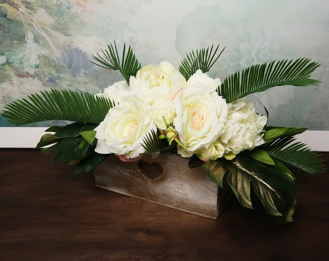Tropical wedding centerpiece with ivory flowers and greenery, realistic silk peonies roses gold monstera leaves modern wedding wooden pot