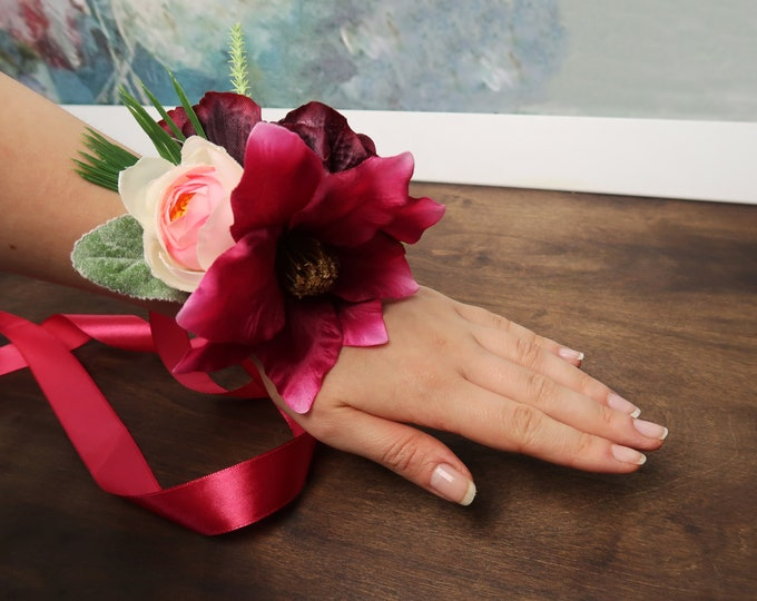 Tropical wrist corsage in fuchsia and burgundy