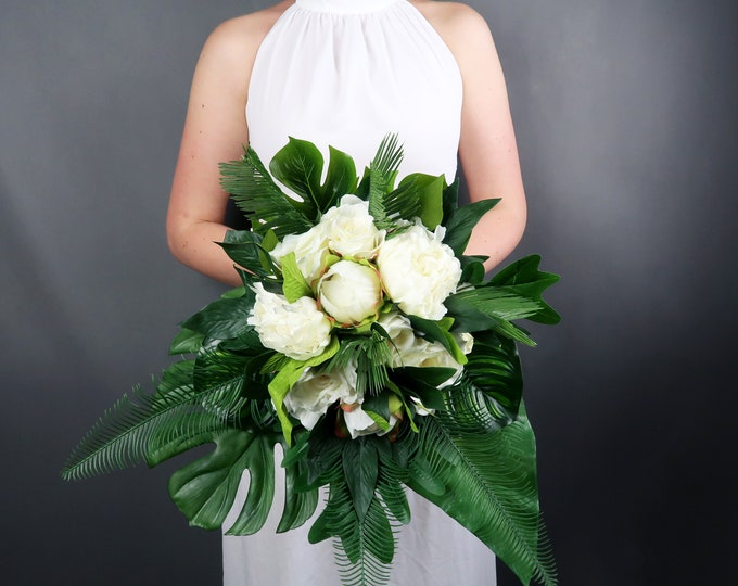 Tropical wedding bouquet with white flowers and greenery, realistic silk peonies roses, monstera leaves, modern wedding bridal flowers ivory