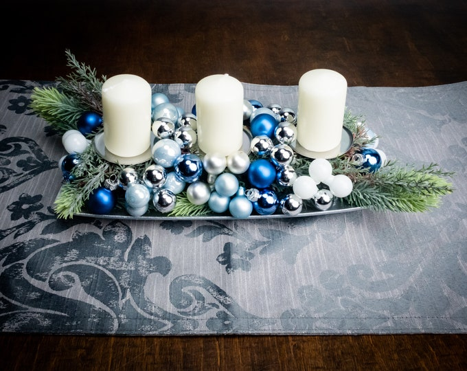 Christmas table decoration silver and blue winter wedding table centerpiece with candles, artificial fir, glass ornaments floral decor