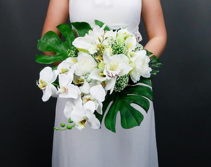 Tropical wedding bouquet with white orchids and greenery, large monstera leaves, realistic silk flowers, modern wedding bridal flowers ivory