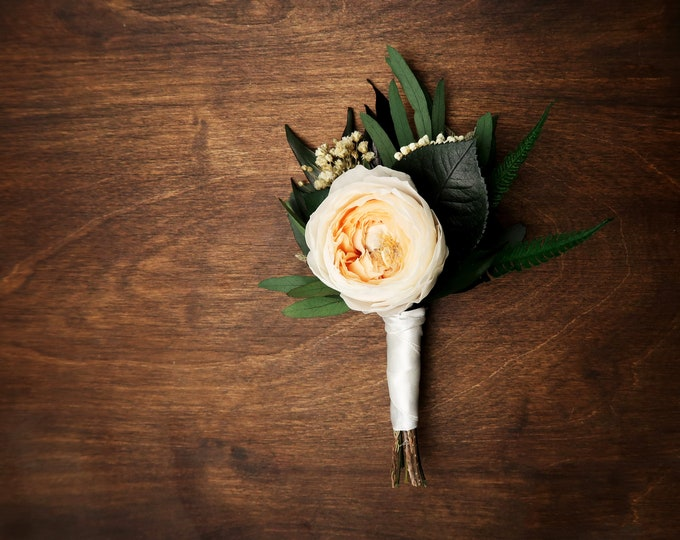 Groom's wedding boutonniere with real peach English rose peony, preserved flowers and eucalyptus greenery