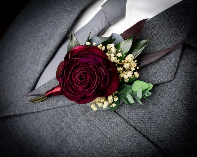 Dark wine burgundy groom's boutonniere, sola rose flower preserved baby's breath eucalyptus greenery, fall winter vintage elegant man