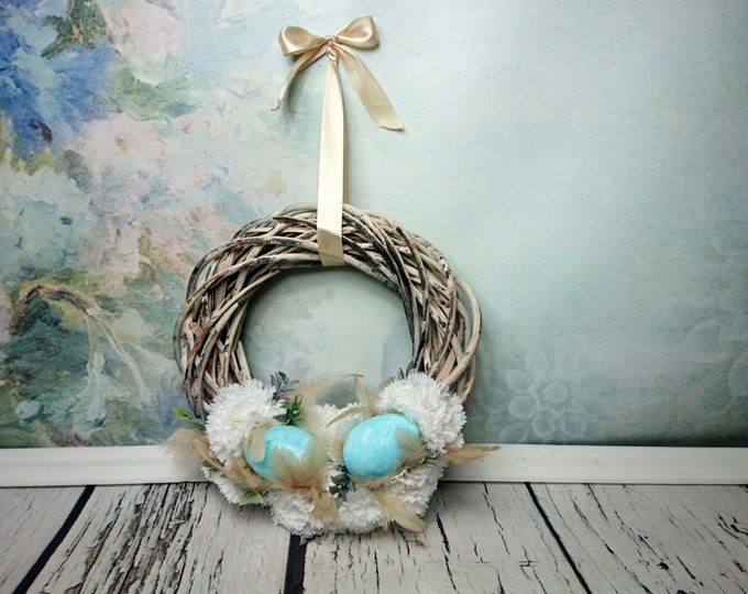 Rustic Easter floral wreath door decoration beige turquoise eggs feathers white carnations wicker satin ribbon bow shabby chic home decor
