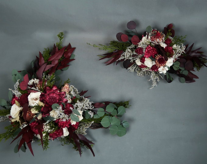 Wedding arch flowers arrangement boho style sola flowers burgundy deep red preserved eucalyptus greenery exotic tropical flowers wild rustic