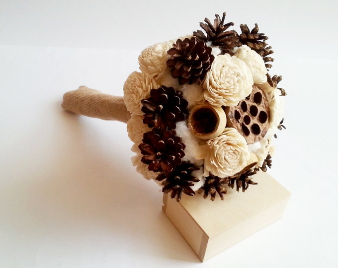 Ivory rustic pine cone bouquet with sola flowers, cotton and burlap, for winter wedding bride