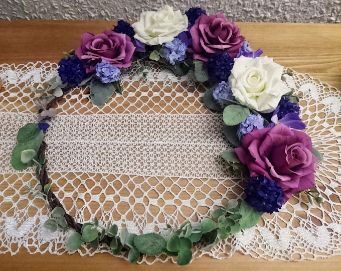 Purple rustic greenery wreath centerpiece hanging backdrop floral arrangement ultraviolet white boho wedding roses romantic simple