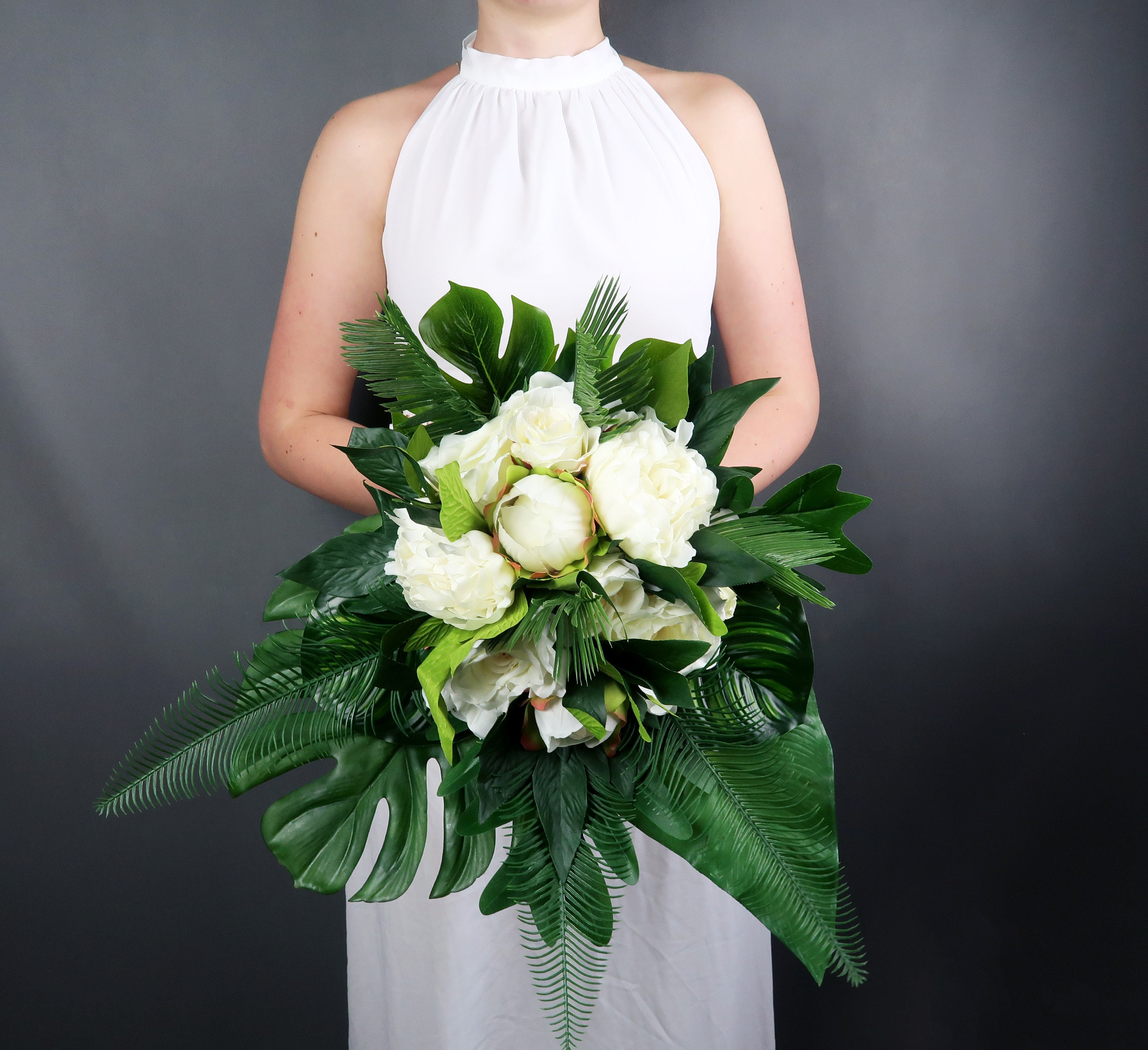 Tropical wedding bouquet with white flowers and greenery mightylinksfo
