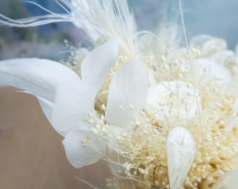 White wedding bridal bouquet with exclusive real preserved flowers and peacock feathers, bleached boho flowers