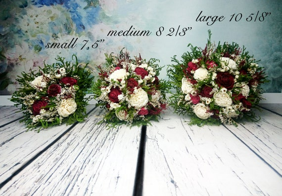 Natural wedding bouquet with cotton bolls greenery rustic woodland winter wedding sola flowers and cedar rose