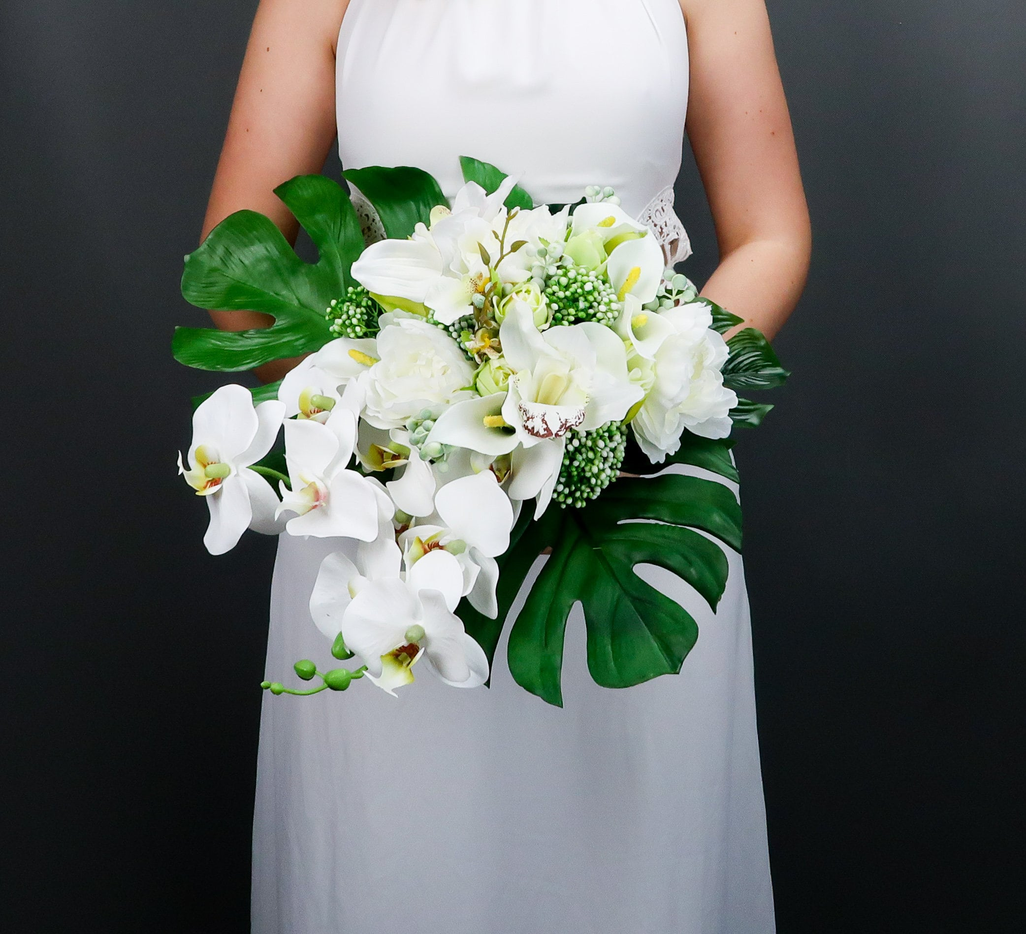 Tropical Wedding Bouquet With White Orchids And Greenery