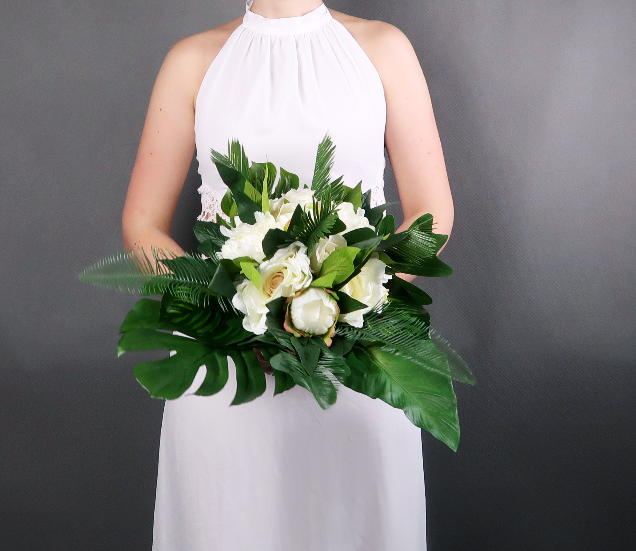 Tropical Wedding Bouquet With White Flowers And Greenery