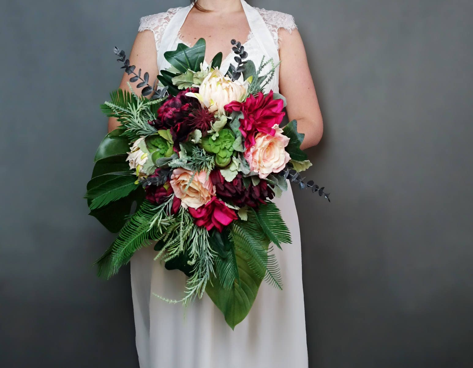 Burgundy, fuchsia and peach tropical flowers wedding bridal bouquet