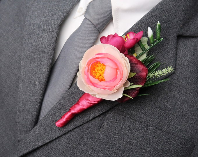 Tropical wedding boutonniere in fuchsia and burgundy